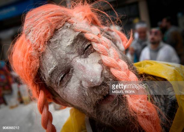 A man reacts as he takes part in the 'Domingo Fareleiro' festival in the village of Xinzo de Limia northwestern Spain on January 21 2018 / AFP PHOTO...