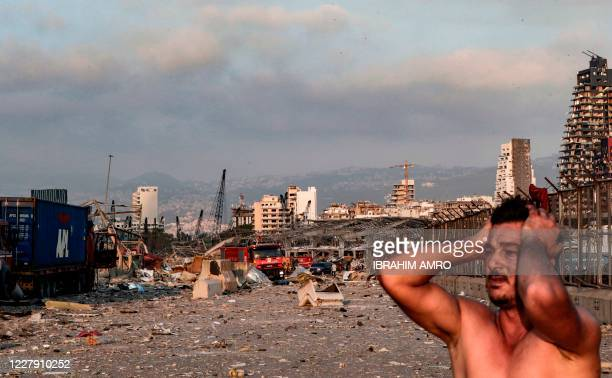 Man reacts at the scene of an explosion at the port in Lebanon's capital Beirut on August 4, 2020. - Two huge explosion rocked the Lebanese capital...