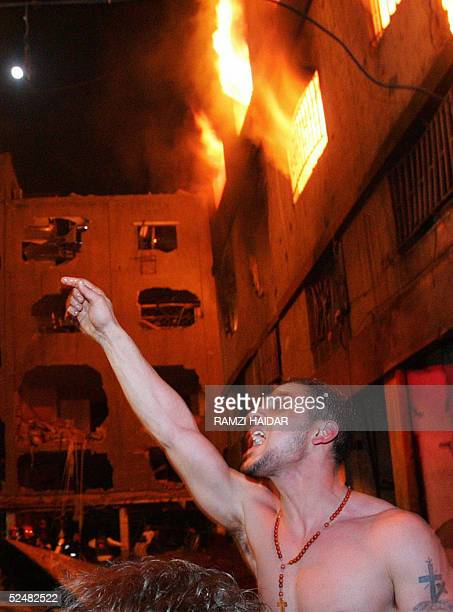 A man reacts during rescue operations at the site of a huge explosion the third in a Christian quarter in the past week in an industrial district...