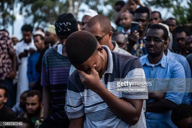 A man reacts during the burial of Feisal Ahmed on January 16 2018 in Nairobi Kenya Ahmed and his colleague were killed after AlShabab militants...