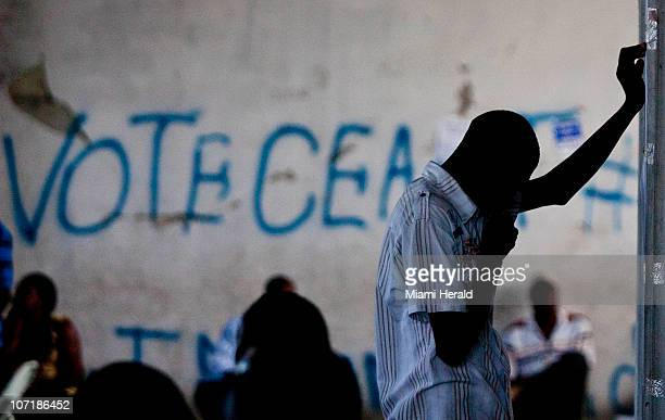 A man reacts in building 2004 in PortauPrince Haiti Sunday November 28 2010 Amid chaos confusion and isolated instances of violence presidential...