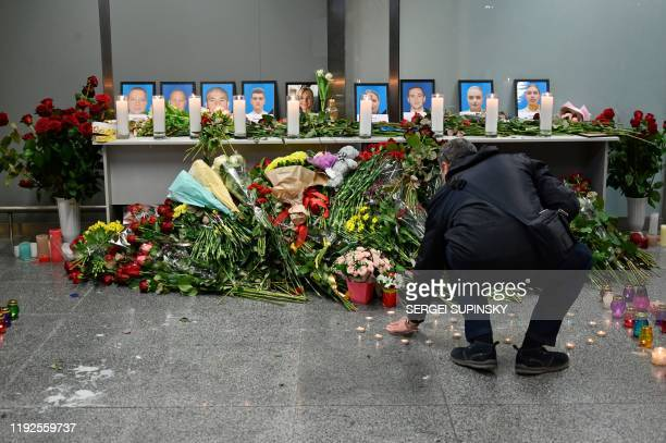 TOPSHOT A man reacts in front of a memorial for the victims of the Ukraine International Airlines Boeing 737800 crash in the Iranian capital Tehran...