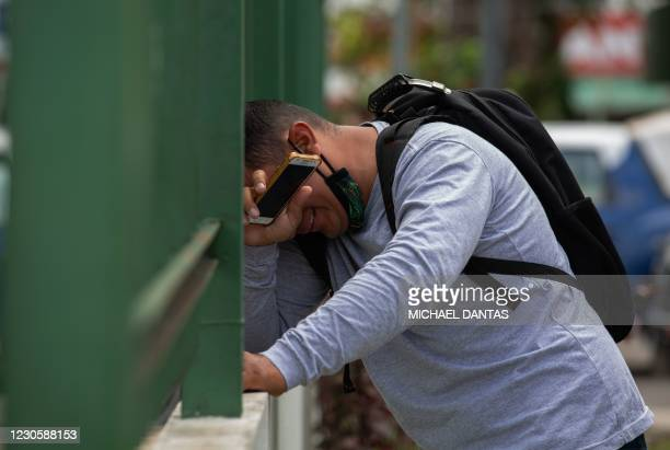 Man reacts outside the 28 de Agosto Hospital in Manaus, Amazon State, Brazil, on January 14 amid the novel coronavirus, COVID-19, pandemic. - Manaus...