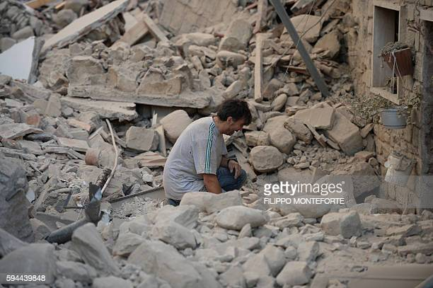 TOPSHOT A man reacts to his damaged home after a strong earthquake hit Amatrice on August 24 2016 Central Italy was struck by a powerful 62magnitude...