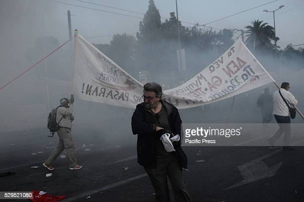 A man reacts to tear gas during clashes in Syntagma square Demonstrations against further austerity in the Greek capital Athens were marked by minor...