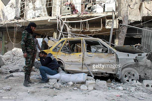 A man reacts to the destruction of his home following a reported Syrian government forces air strike the day before in the northern city of Aleppo on...