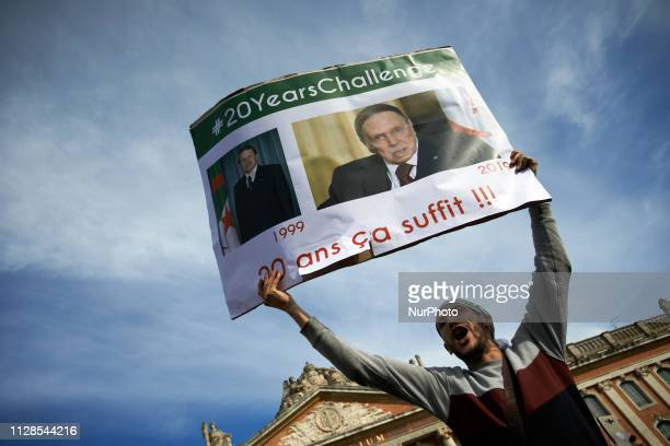 A man reacts while holding a placard reading '20 years it's enough' Algerians in Toulouse gathered on the main square of Toulouse the Capitole to...