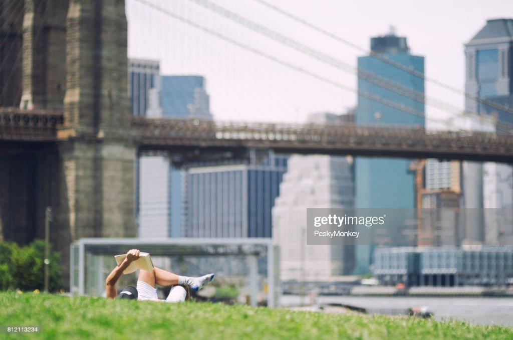 Man Reading A Book At Brooklyn Bridge Park Nyc Stock Photo
