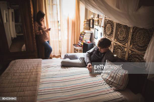 man reading a book in the bedroom