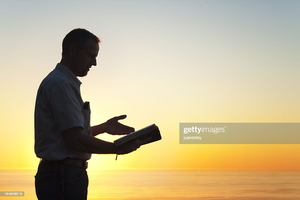 Man Reading A Book of Knowledge : Stock Photo