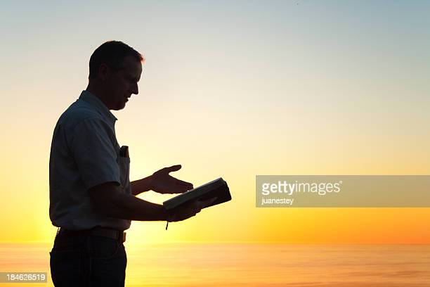 Man Reading A Book of Knowledge