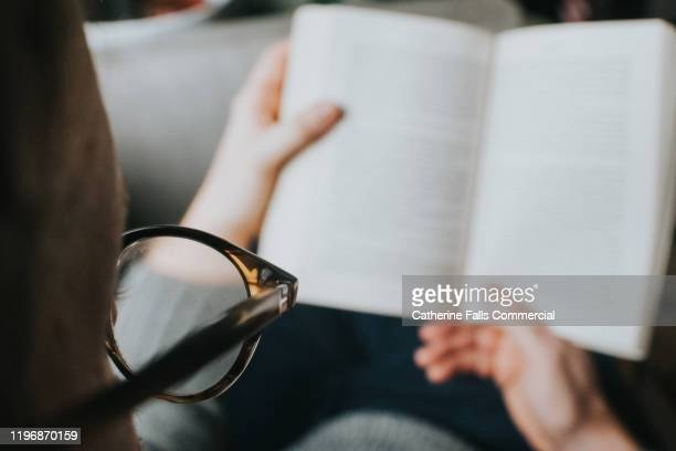 man reading a book - eyesight stock pictures, royalty-free photos & images