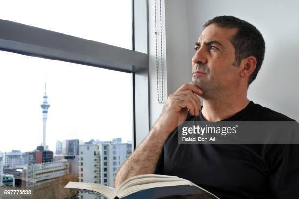 man reading a book - rafael ben ari stock pictures, royalty-free photos & images