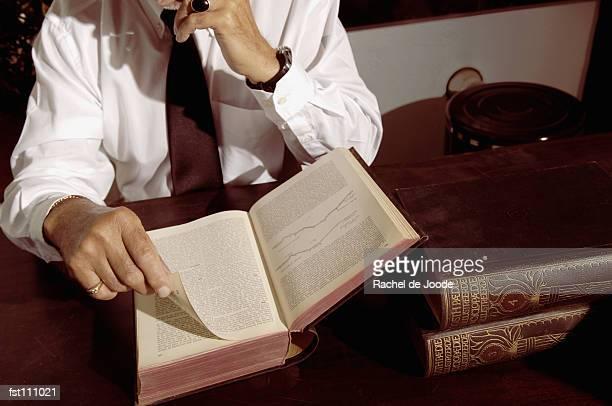 man reading a book - enzyklopädie stock-fotos und bilder