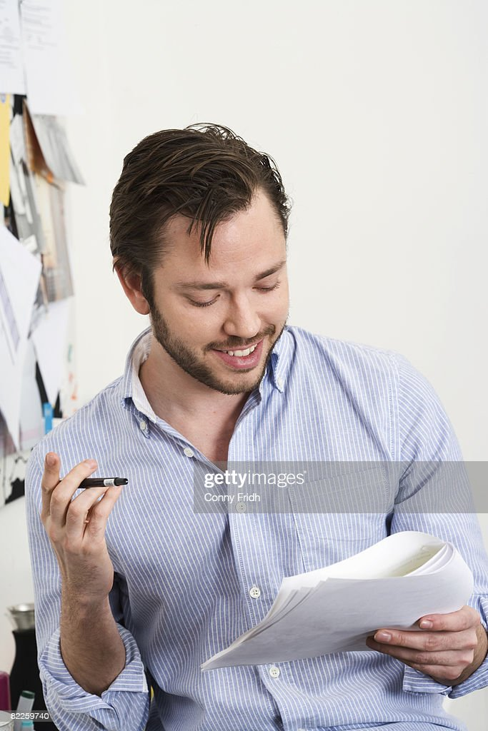 A man reading a document Sweden. : Stock Photo