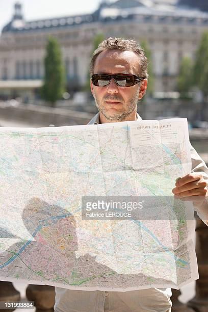 Man reading a map, Terrasse De l'Orangerie, Jardin des Tuileries, Paris, Ile-de-France, France