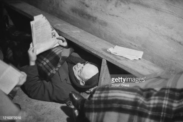 A man reading a newspaper in an air raid shelter during the Blitz London October 1940 Original Publication Picture Post 308 Shelter Life pub 26th...