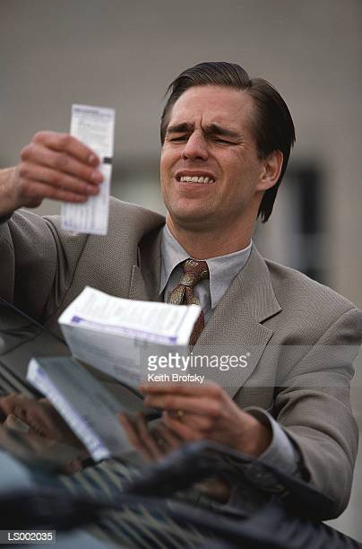 Man Reading a Parking Ticket