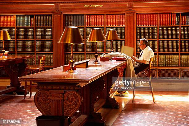 man reading at new york public library - bo zaunders stock pictures, royalty-free photos & images