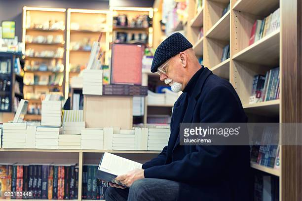 Man Reading Book In Bookstore
