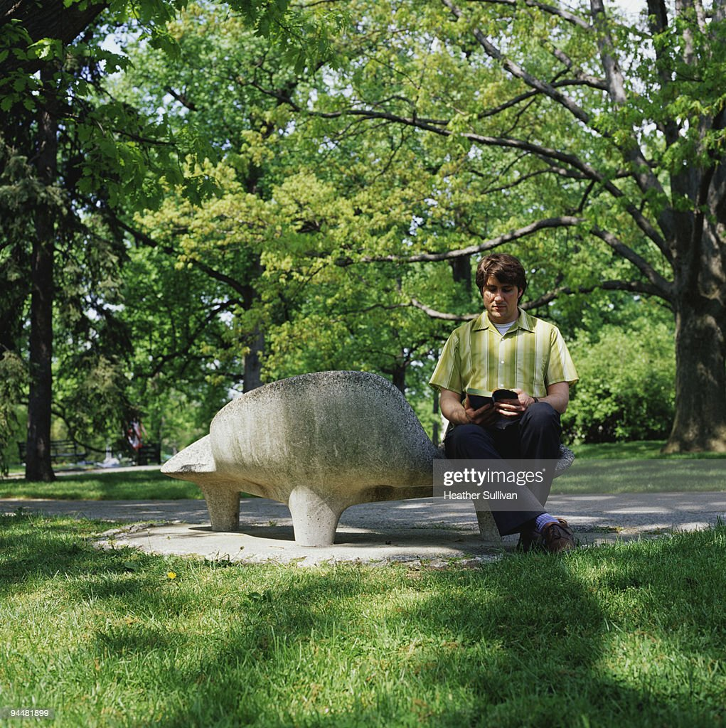 Man reading book in park : Stock Photo