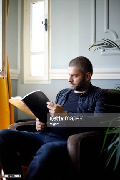 man reading book - nature magazine stock pictures, royalty-free photos & images