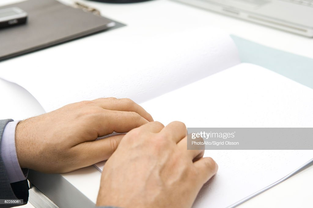 Man reading braille, cropped view of hands : Stock Photo