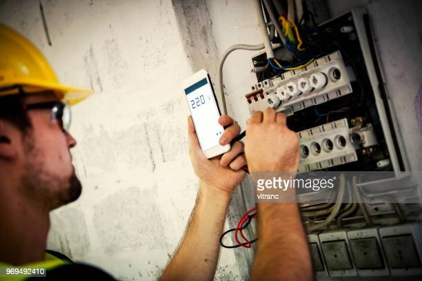 man reading electric meter - meter instrument of measurement stock pictures, royalty-free photos & images