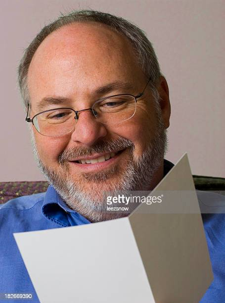 man reading greeting card - thinking of you card stock pictures, royalty-free photos & images