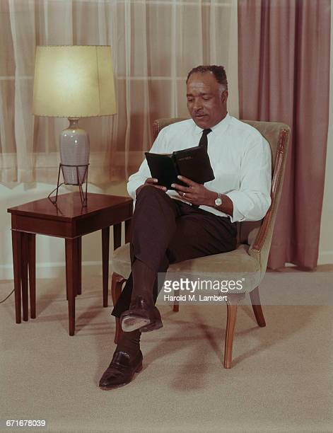 man reading holy bible  - neckwear stock pictures, royalty-free photos & images