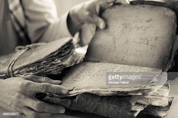 Man reading in Hindu scriptures - Nepal