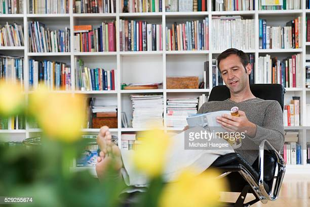 Man Reading in Home Library