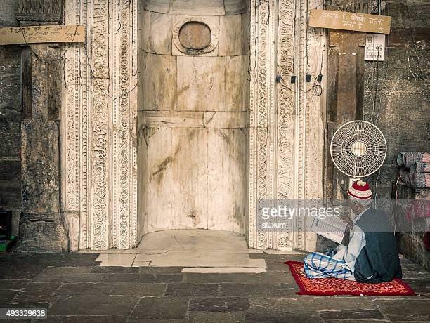 man reading koran in mosque in ajmer india - mosque stock pictures, royalty-free photos & images