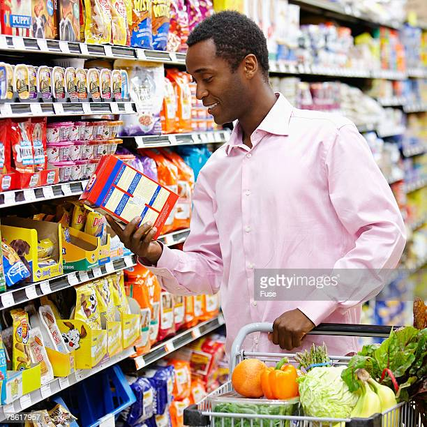 Man Reading Label in Grocery Store