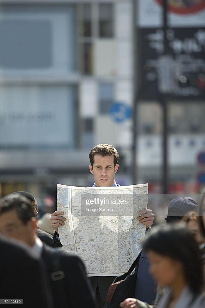 Man reading map : Stock Photo