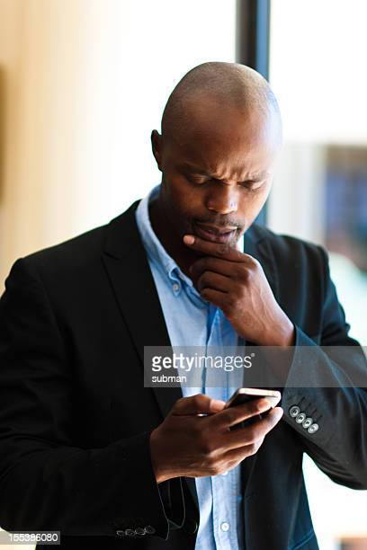 Man reading message on his phone