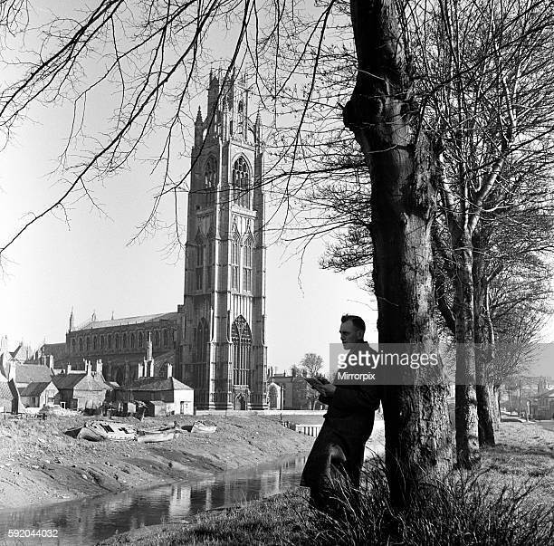A man reading near St Botolph's Church in Boston Lincolnshire 2nd April 1953