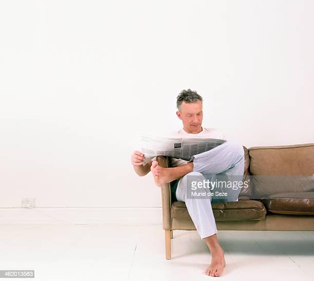 Man reading newspaper home