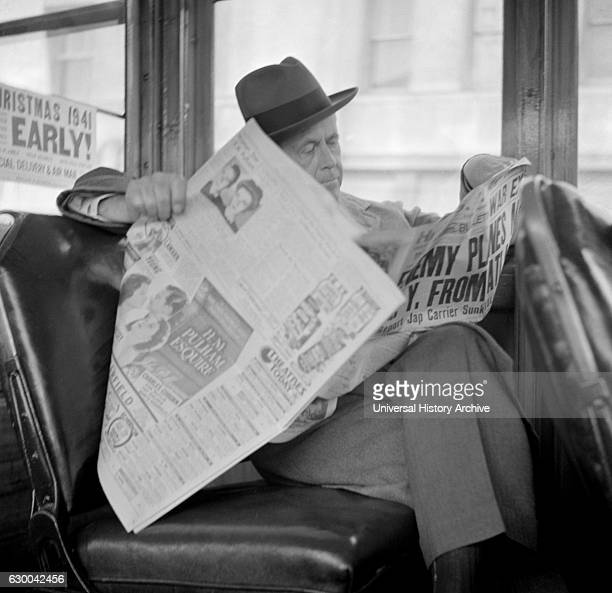 Man Reading Newspaper on Bus Monday Morning after Japanese Attack on Pearl Harbor San Francisco California USA December 8 1941
