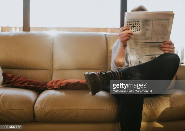 man reading newspaper - beige shoe stock pictures, royalty-free photos & images