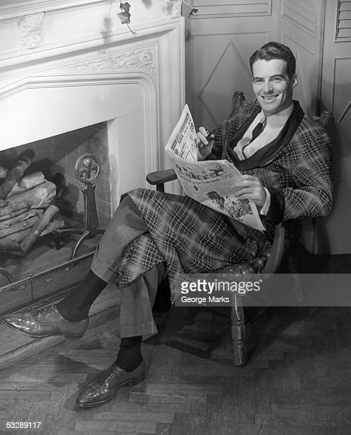 man reading newspaper - smoking jacket stock photos and pictures