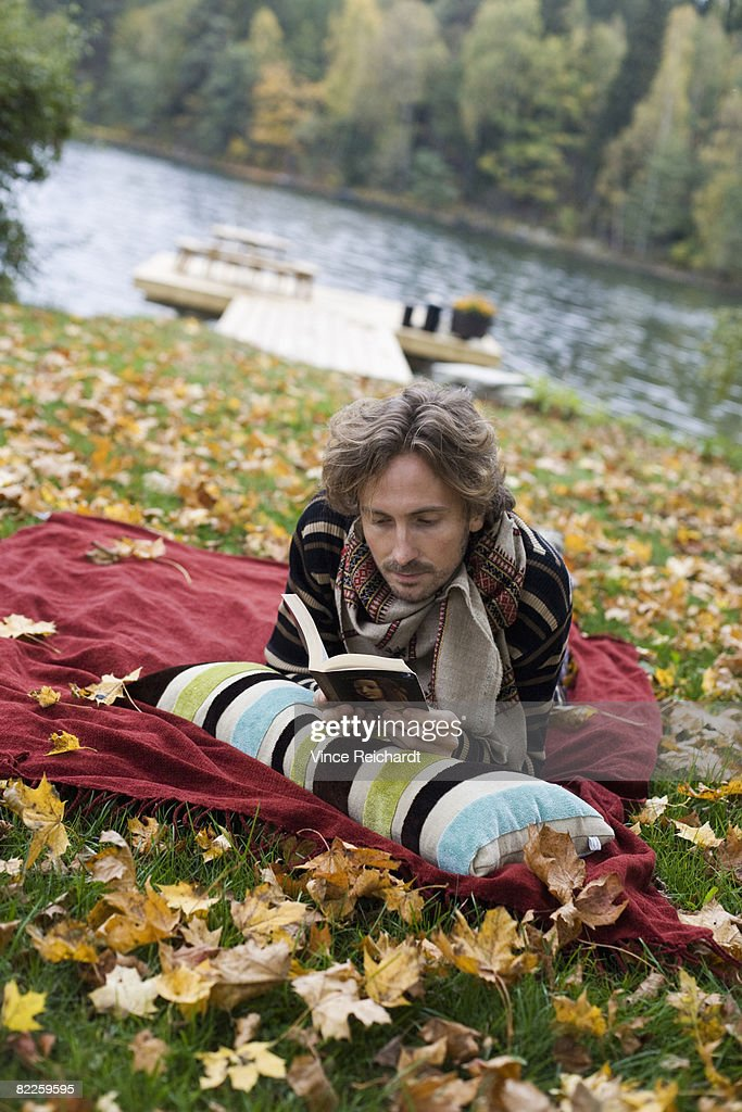 A man reading on a blanket Sweden. : Stock Photo