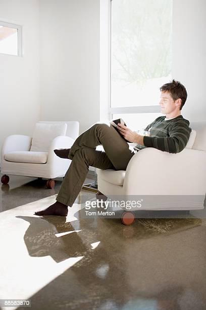 Man reading on modern living room