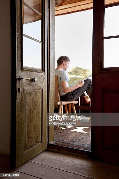 Man reading on porch