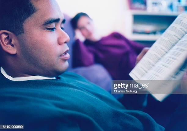 Man Reading on Sofa