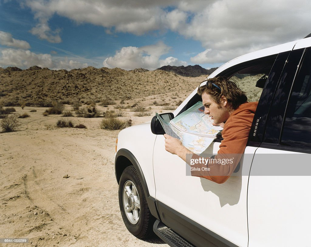 Man Reading Road Map : Stock Photo