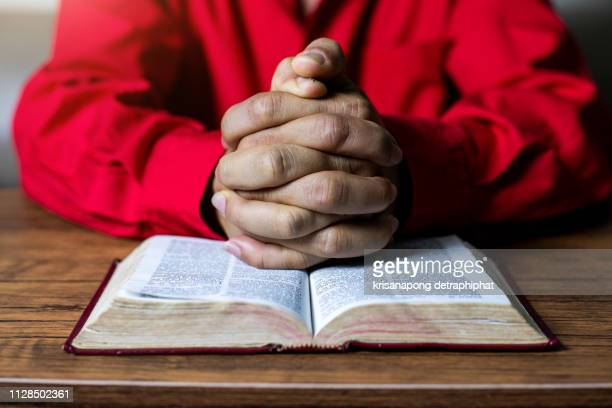 a man reading the holy bible - christianity stock pictures, royalty-free photos & images