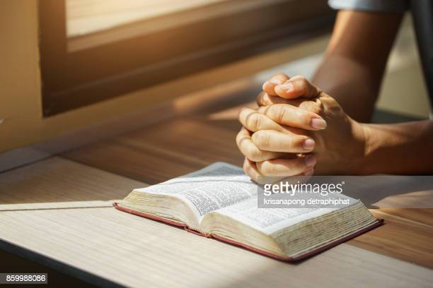 a man reading the holy bible. - religion stock-fotos und bilder