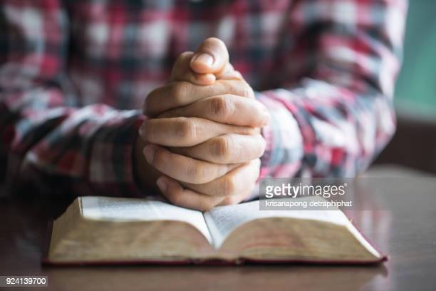 a man reading the holy bible. - catholicism stock pictures, royalty-free photos & images