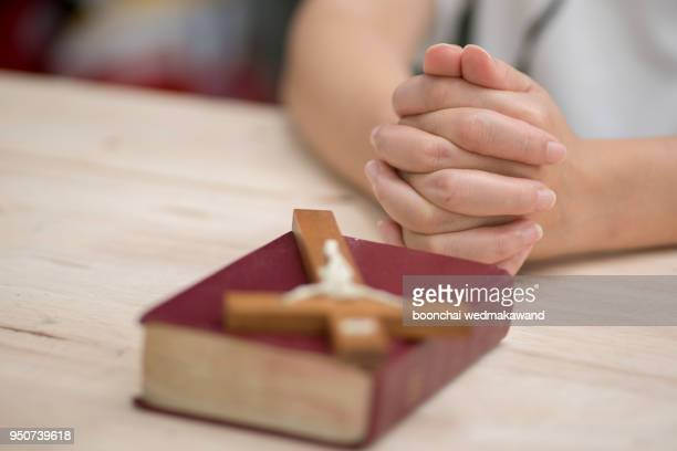 a man reading the holy bible. - christianity stock photos and pictures